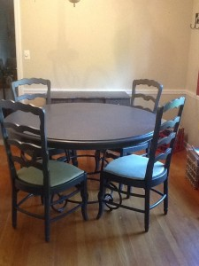 iron base, gray table and four ladder-back chairs